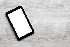 Ψηφιακή ταμπλέτα σε ένα γκρίζο ξύλινο υπόβαθρο στοκ φωτογραφία με δικαίωμα ελεύθερης χρήσης