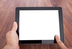 Ψηφιακή ταμπλέτα εκμετάλλευσης προσώπων Στοκ εικόνες με δικαίωμα ελεύθερης χρήσης