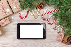 Ψηφιακή χλεύη ταμπλετών επάνω στο πρότυπο για app Χριστουγέννων την παρουσίαση ή την προώθηση ιστοχώρου Στοκ φωτογραφία με δικαίωμα ελεύθερης χρήσης
