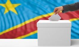 Ψηφοφόρος σε ένα υπόβαθρο σημαιών του Κονγκό τρισδιάστατη απεικόνιση Στοκ Εικόνες