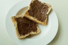 Ψωμί με την κρέμα σοκολάτας Στοκ Εικόνες