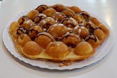 Ψωμί που ψεκάζεται με τη σοκολάτα στοκ εικόνα