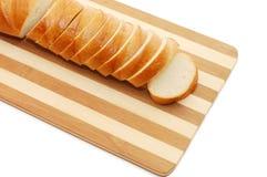 ψωμί χαρτονιών που τεμαχίζ&epsi Στοκ Εικόνα