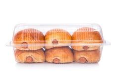 Ψωμιά σε ένα σαφές πλαστικό κιβώτιο που απομονώνεται Στοκ εικόνα με δικαίωμα ελεύθερης χρήσης