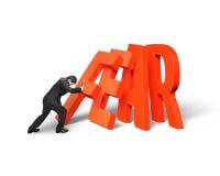 Ωθώντας ντόμινο επιχειρηματιών της κόκκινης πτώσης λέξης φόβου στοκ εικόνα με δικαίωμα ελεύθερης χρήσης