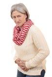 Ωριμασμένη γυναίκα με τη μόλυνση κύστεων στοκ εικόνα