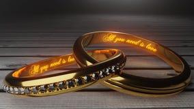 Όλη που χρειάζεστε είναι αγάπη - χρυσά γαμήλια δαχτυλίδια που ενώνονται μαζί για πάντα με χαραγμένος και να φορέσει γάντια λέξεις ελεύθερη απεικόνιση δικαιώματος