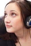όμορφα ακουστικά κοριτσιών Στοκ φωτογραφία με δικαίωμα ελεύθερης χρήσης