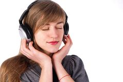 όμορφα ακουστικά κοριτσ Στοκ Εικόνες