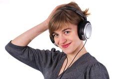 όμορφα ακουστικά κοριτσ Στοκ Εικόνα