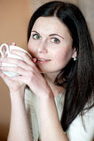 Όμορφα κορίτσι και τσάι Στοκ Εικόνα