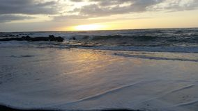 Όμορφα sunsets στη μαύρη παραλία 14 άμμου Στοκ εικόνες με δικαίωμα ελεύθερης χρήσης