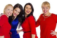 όμορφες τέσσερις νεολαίες λευκών γυναικών ομάδας ευτυχείς απομονωμένες προκλητικές Απομονωμένος στο whi στοκ εικόνα