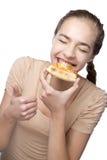 όμορφες τρώγοντας νεολαίες γυναικών Στοκ Φωτογραφία