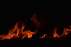 Όμορφες φλόγες πυρκαγιάς στο μαύρο υπόβαθρο Στοκ Εικόνα