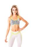 Όμορφη αθλητική θηλυκή τοποθέτηση στο άσπρο υπόβαθρο στοκ φωτογραφία με δικαίωμα ελεύθερης χρήσης