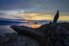 Όμορφη ανατολή με τις ακτίνες που σπάζουν μέσω των σύννεφων Στοκ Φωτογραφία