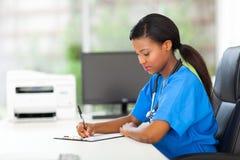 Εκθέσεις γραψίματος νοσοκόμων Στοκ Εικόνες