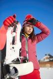 Όμορφη γυναίκα με ένα σνόουμπορντ απομονωμένο έννοια αθλητικό λευκό Στοκ Εικόνες