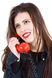 Όμορφη γυναίκα με το αναδρομικό τηλέφωνο Στοκ Εικόνα