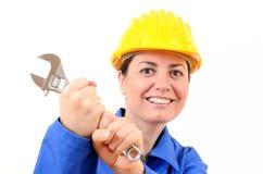 Όμορφη γυναίκα με το γαλλικό κλειδί στο χέρι του Στοκ εικόνα με δικαίωμα ελεύθερης χρήσης
