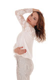 Όμορφη γυναίκα που στέκεται στο σχεδιάγραμμα Στοκ φωτογραφία με δικαίωμα ελεύθερης χρήσης
