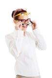 Όμορφη γυναίκα που φορά τέσσερα διαφορετικά ζευγάρια eyeglasses. Στοκ Εικόνες