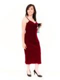 Όμορφη γυναίκα σε ένα κόκκινο φόρεμα που κρατά ένα κόκκινο κρασί Στοκ Φωτογραφίες