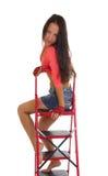 Όμορφη γυναίκα στη σκάλα, που απομονώνεται Στοκ Φωτογραφίες