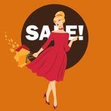 Όμορφη γυναίκα στις πωλήσεις φθινοπώρου Η γυναίκα στο κόκκινο φόρεμα πηγαίνει Στοκ Φωτογραφίες