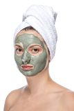 Όμορφη γυναίκα την του προσώπου μάσκα, που απομονώνεται με Στοκ Φωτογραφίες