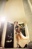 Όμορφη γυναίκα redhair στο βράχο styleclothes με την τέχνη σωμάτων τον Στοκ Εικόνα