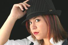 όμορφη εκμετάλλευση καπέλων κοριτσιών Στοκ Φωτογραφία