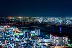 Όμορφη εναέρια άποψη νύχτας της εικονικής παράστασης πόλης της Οζάκα, Ιαπωνία Στοκ Φωτογραφία