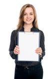 Όμορφη επιχειρησιακή γυναίκα με ένα άσπρο έμβλημα Στοκ Εικόνα