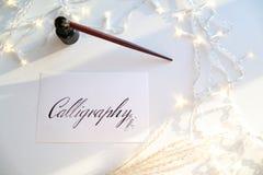 Όμορφη κάρτα με την καλλιγραφική επιγραφή του μαύρου μελανιού επάνω Στοκ Εικόνες