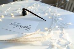Όμορφη κάρτα με την καλλιγραφική επιγραφή του μαύρου μελανιού επάνω Στοκ φωτογραφία με δικαίωμα ελεύθερης χρήσης