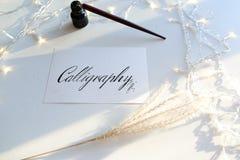 Όμορφη κάρτα με την καλλιγραφική επιγραφή του μαύρου μελανιού επάνω Στοκ Φωτογραφία
