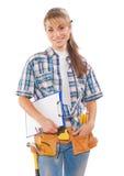 Όμορφη νέα γυναίκα εργαζόμενος με τα εργαλεία κατασκευής που κρατά το CL Στοκ Φωτογραφίες
