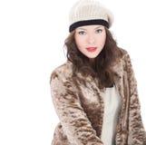 Όμορφη νέα γυναίκα σε ένα παλτό Στοκ Φωτογραφίες