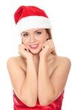 Όμορφη νέα γυναίκα στο κόκκινο που φορά το καπέλο santa. Στοκ Εικόνα