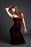 Όμορφη νέα γυναίκα στο φόρεμα κομψότητας Στοκ φωτογραφία με δικαίωμα ελεύθερης χρήσης