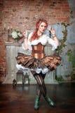 Όμορφη περιστροφή γυναικών steampunk στοκ φωτογραφία
