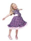Όμορφη περιστροφή μικρών κοριτσιών γύρω από απομονωμένος στοκ εικόνα με δικαίωμα ελεύθερης χρήσης