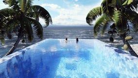 Όμορφη πισίνα με το λούζοντας άνδρα και τη γυναίκα στην ηλιόλουστη ημέρα, σε ένα χαμένο τροπικό νησί r ελεύθερη απεικόνιση δικαιώματος