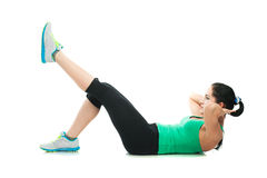 Όμορφη φίλαθλη γυναίκα που κάνει την άσκηση στο πάτωμα Στοκ εικόνα με δικαίωμα ελεύθερης χρήσης