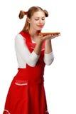 Όμορφη χαμογελώντας νοικοκυρά στην κόκκινη ποδιά με το αστείο holdi ponytails Στοκ φωτογραφία με δικαίωμα ελεύθερης χρήσης