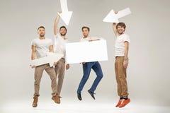 Όμορφοι σπουδαστές που πηδούν με τα σύμβολα Στοκ εικόνα με δικαίωμα ελεύθερης χρήσης