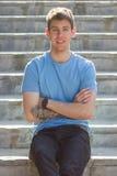 Όμορφος αρσενικός διαστισμένος έφηβος βραχίονας στοκ εικόνα με δικαίωμα ελεύθερης χρήσης