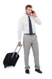 Όμορφος επιχειρηματίας που απαντά στο τηλέφωνο Στοκ Φωτογραφίες